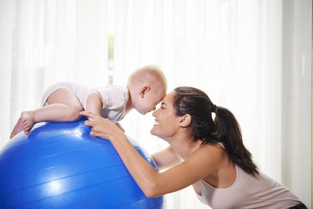 Mother and baby exercising at home